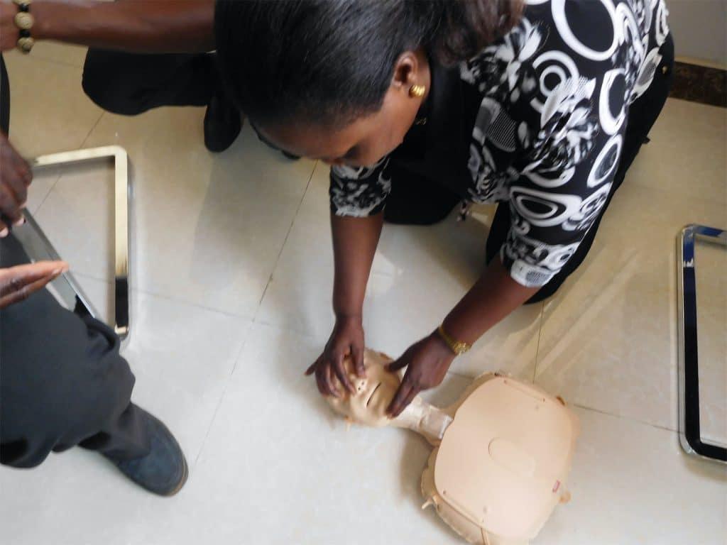 Ghana staff member learning CPR