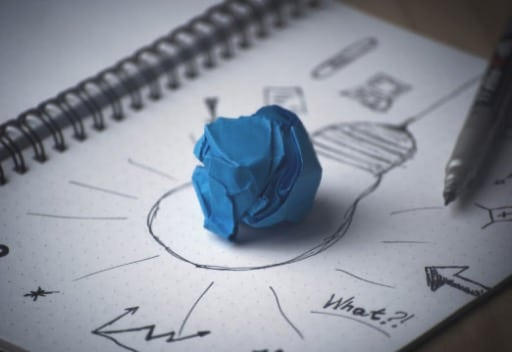 Drawing of lightbulb with crumpled paper.