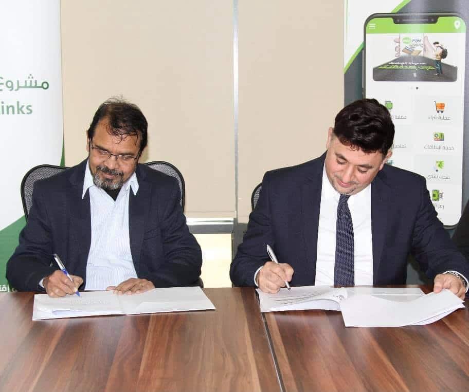 2 men sign documents